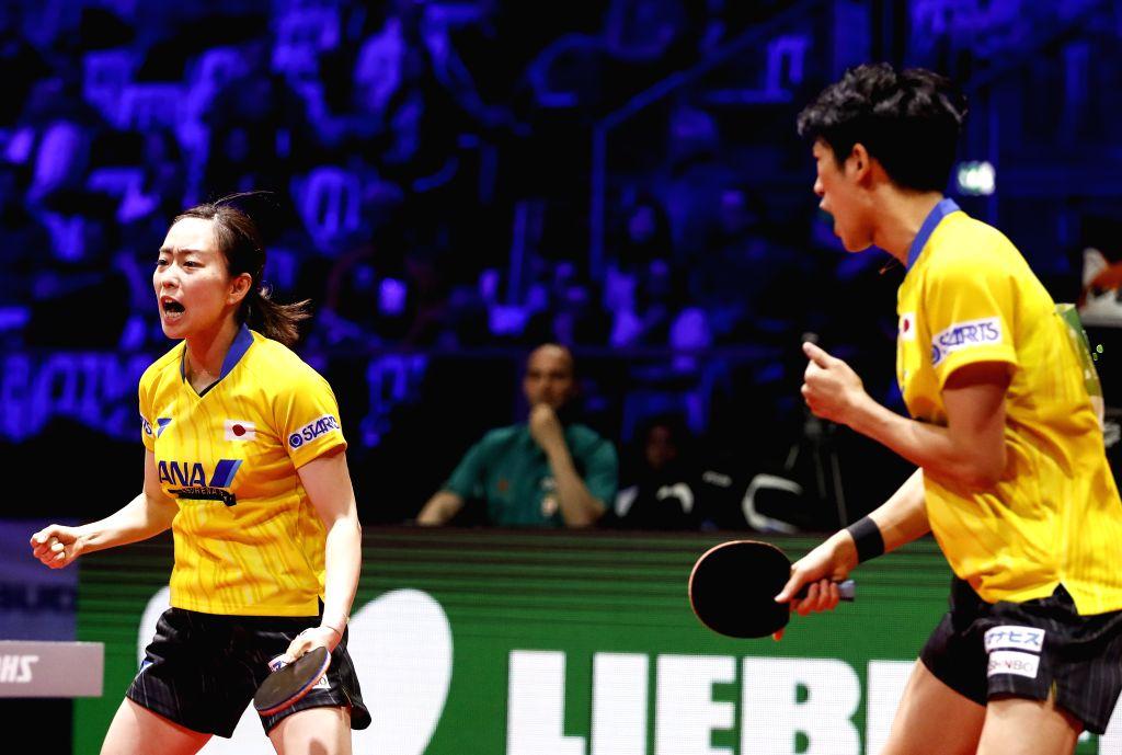 BUDAPEST, April 24, 2019 - Yoshimura Maharu /Ishikawa Kasumi (L) of Japan compete during the mixed doubles round of 16 match with Adam Szudi/Szandra Pergel of Hungary at 2019 ITTF World Table Tennis ...