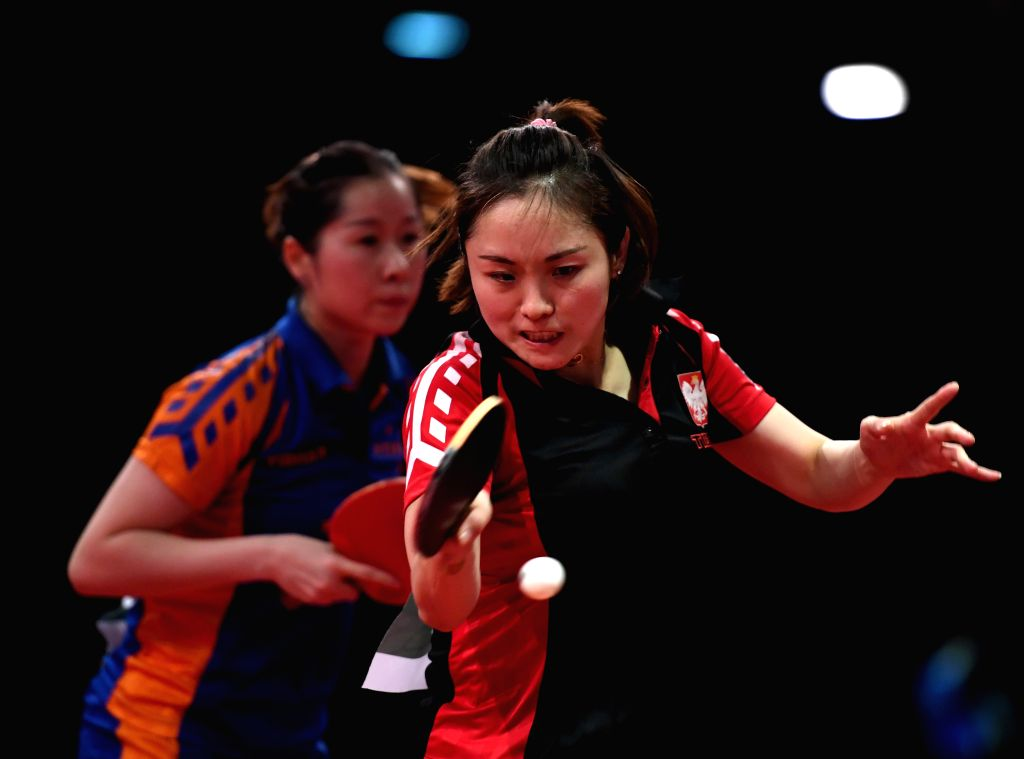 BUDAPEST, April 25, 2019 - Li Qian (R) of Poland/Li Jie of the Netherlands compete during the women's doubles round of 16 match against Chen Meng/Zhu Yuling  of China at 2019 ITTF World Table Tennis ...