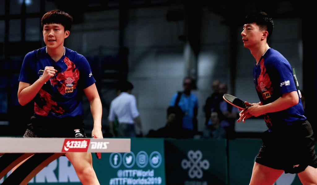 BUDAPEST, April 25, 2019 - Ma Long (R)/Wang Chuqin of China compete during the men's doubles round of 16 match against Chen Chien-An/Chuang Chih-Yuan of Chinese Taipei at 2019 ITTF World Table Tennis ...