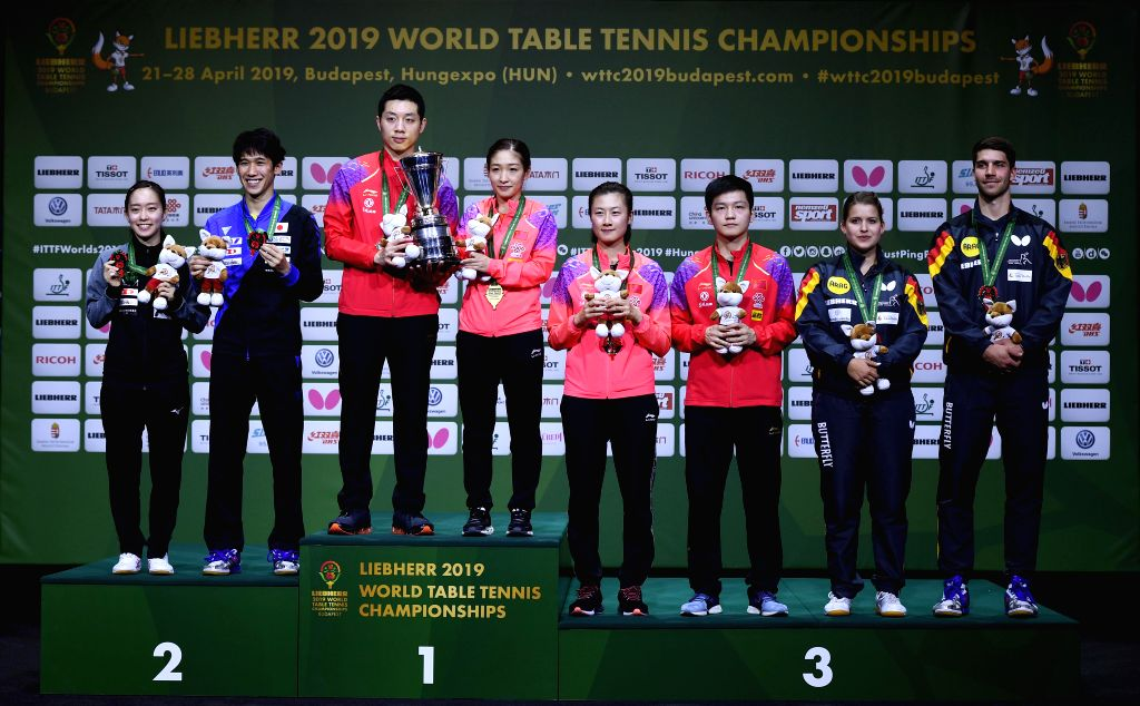 BUDAPEST, April 26, 2019 - Medalists pose on the podium during the awarding ceremony of the mixed doubles at 2019 ITTF World Table Tennis Championships in Budapest, Hungary on April 26, 2019.