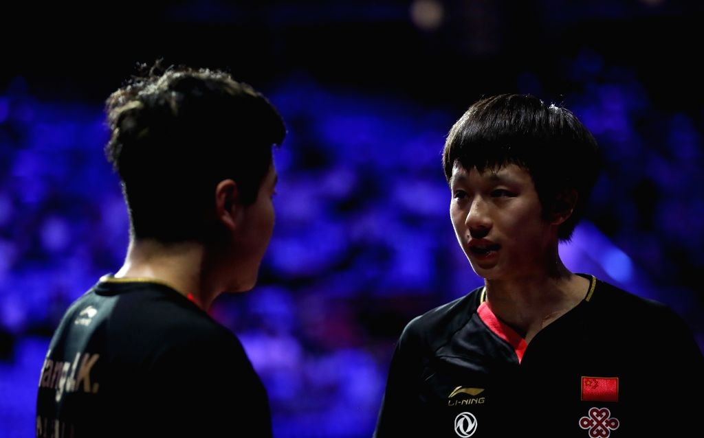BUDAPEST, April 27, 2019 - Liang Jingkun/Lin Gaoyuan (R) of China react during the men's doubles semifinal match against Ma Long/Wang Chuqin of China at 2019 ITTF World Table Tennis Championships in ...