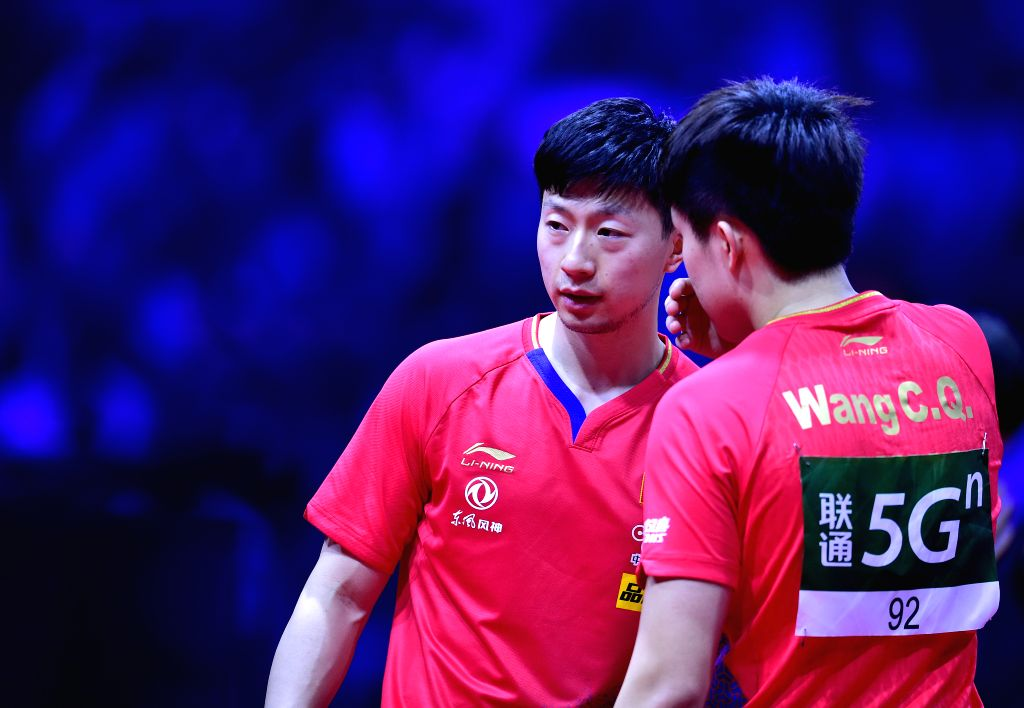 BUDAPEST, April 27, 2019 - Ma Long(L)/Wang Chuqin of China react during the men's doubles semifinal match against Liang Jingkun/Lin Gaoyuan of China at 2019 ITTF World Table Tennis Championships in ...