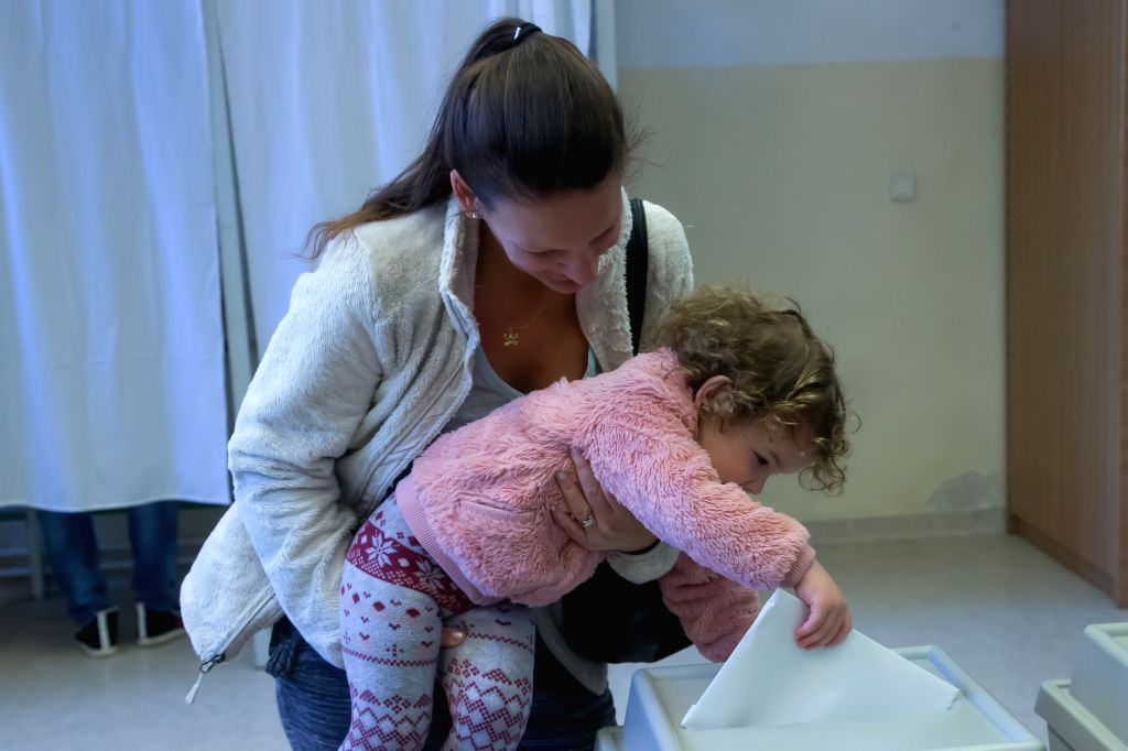 BUDAPEST, April 8, 2018 - A child helps her mother to cast the ballot at a polling station in Budapest, Hungary on April 8, 2018. Hungary started general elections on Sunday to elect a 199-seat ... - Viktor Orban