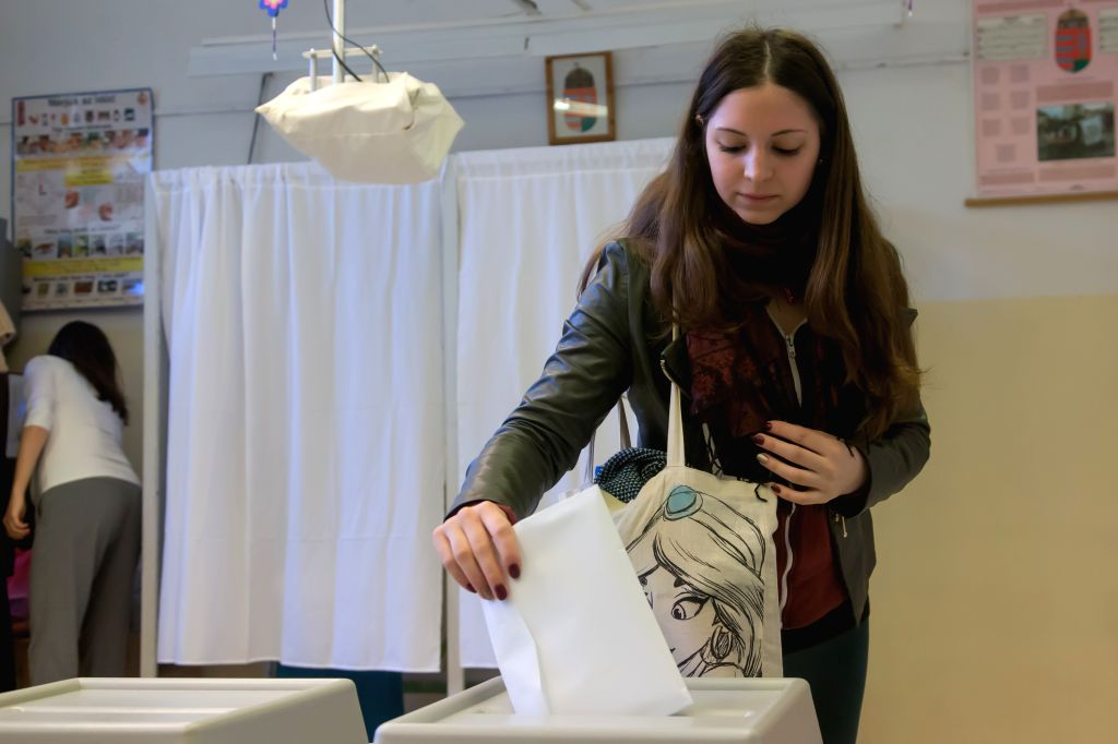 BUDAPEST, April 8, 2018 - A woman casts her ballot at a polling station in Budapest, Hungary on April 8, 2018. Hungary started general elections on Sunday to elect a 199-seat parliament, which could ... - Viktor Orban