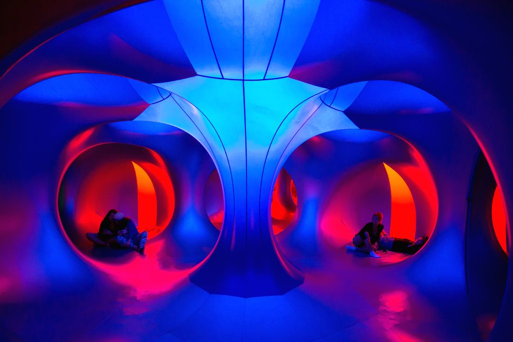 """Festival goers rest in the colour lights of a Luminarium during the Sziget (Hungarian for """"Island"""") Festival on the Obuda Island in Budapest, Hungary on ."""