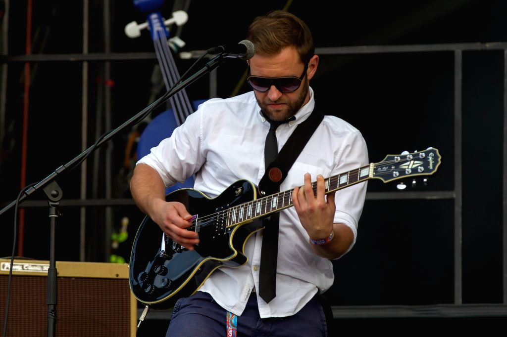 """Szabolcs Ivanyi, guitar player of the Hungarian band Punnany Massif plays at a concert during the Sziget (Hungarian for """"Island"""") Festival on the Obuda .."""
