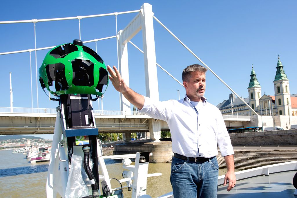 Ulf Spitzer, Google Street View program manager, speaks beside the 360 degree cameras on a ship at a press conference in Budapest, Hungary, August 18, 2014. The ...