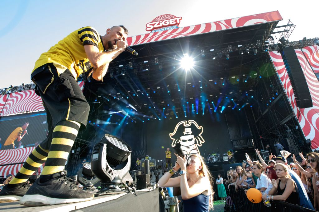 BUDAPEST, Aug. 9, 2017 - Almir Hasanbegovic, vocalist of the band Dubioza Kolektiv from Bosnia and Herzegovina, performs during the 25th Sziget Festival in Budapest, Hungary on Aug. 9, 2017. The 25th ...