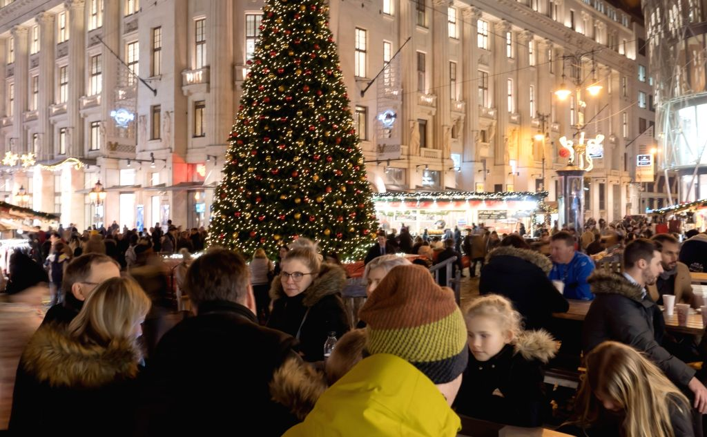 BUDAPEST, Dec. 5, 2018 - People visit a Christmas market in Budapest, Hungary, on Dec. 4, 2018.