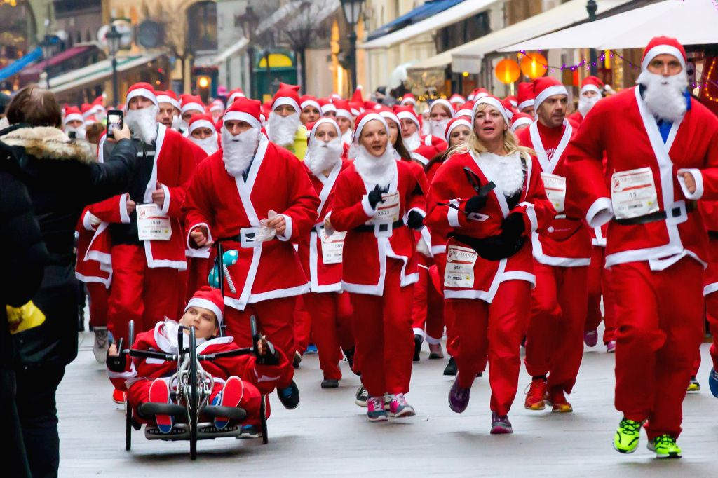 Budapest (Hungary):  People dressed in Santa Claus costumes participate in the first Santa Run in Budapest, Hungary, on Dec. 6, 2014.