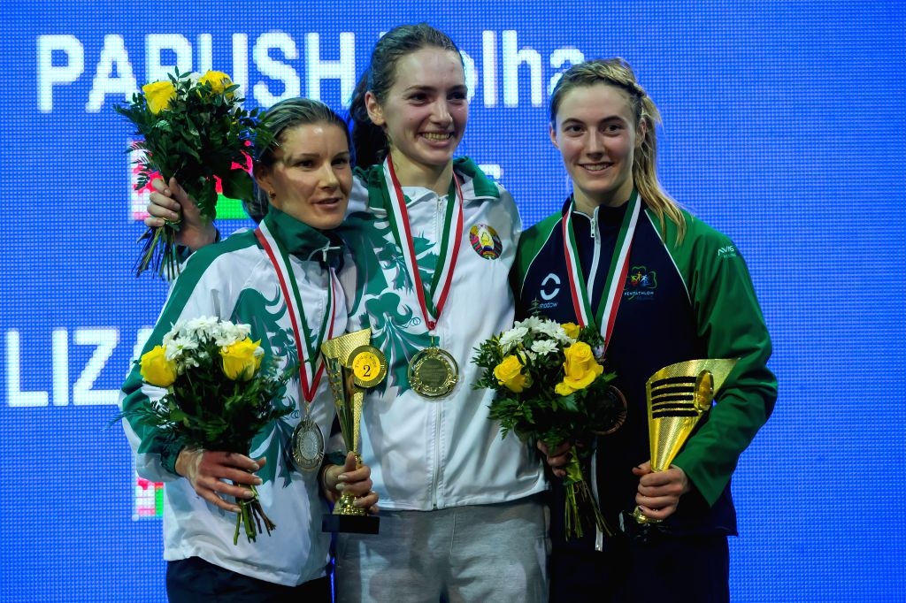 Gold medalist Volha Papush (C) of Belarus, silver medalist Tatsiana Yelizarova (L) of Belarus and bronze medalist Natalya Coyle of Ireland pose during the awarding