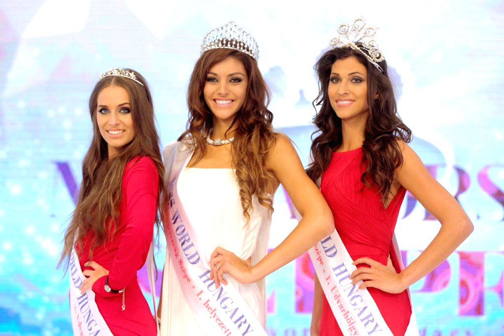 Newly crowned Miss World Hungary Edina Kulcsar (C) poses with runner-ups Gitta Katona (R) and Sydney Van Den Bosch (L) after winning the Miss World Hungary beauty .