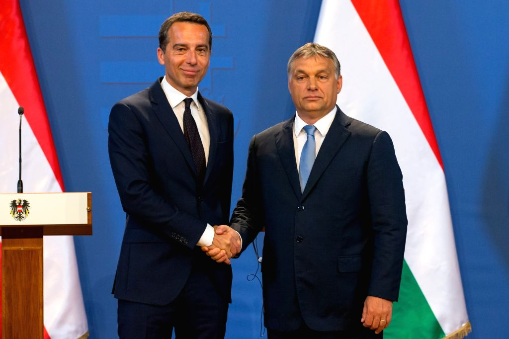 BUDAPEST, July 26, 2016 - Hungarian Prime Minister Viktor Orban(R) shakes hands with Austrian Chancellor Christian Kern during a joint press conference after their meeting in Budapest, Hungary on ... - Viktor Orban
