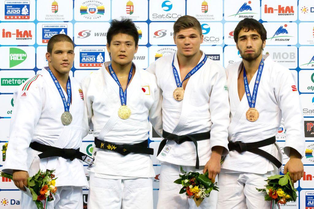 Gold medalist Daiki Nishiyama (2nd L) of Japan, silver medalist Krisztian Toth (L) of Hungary, bronze medalists Khusen Khalmurzaev(R) of Russia and Noel Van T End .