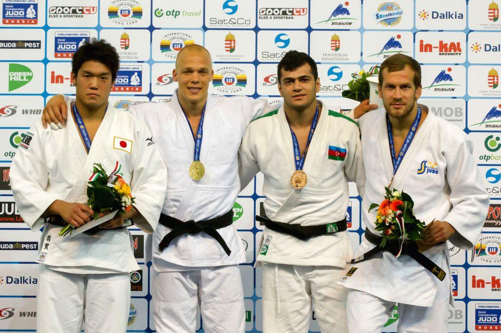 Gold medalist Henk Grol (2nd L) of Netherlands, silver medalist Ryunosuke Haga (L) of Japan, bronze medalists Elmar Gasimov (2nd R) of Azerbaijan and Martin Pacek .