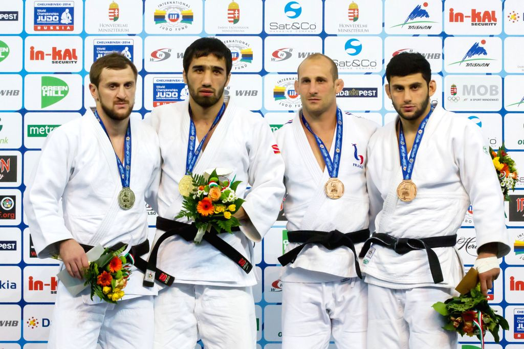 Gold medalist Khasan Khalmurzaev (2nd L) of Russia, silver medalist Sirazhudin Magomedov (L) of Russia, bronze medalists Alain Schmitt (2nd R) of France and Roman .
