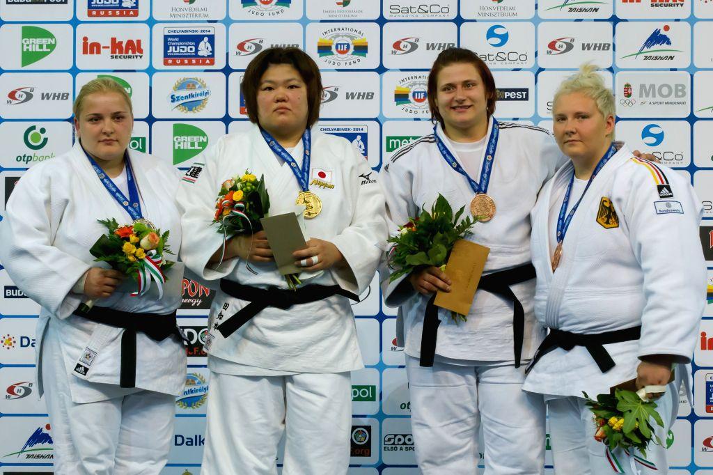 Gold medalist Megumi Tachimoto (2nd L) of Japan, silver medalist Svitlana Iaromka (L) of Ukraine, bronze medalists Larisa Ceric (2nd R) of Bosnia and Herzegovina ..