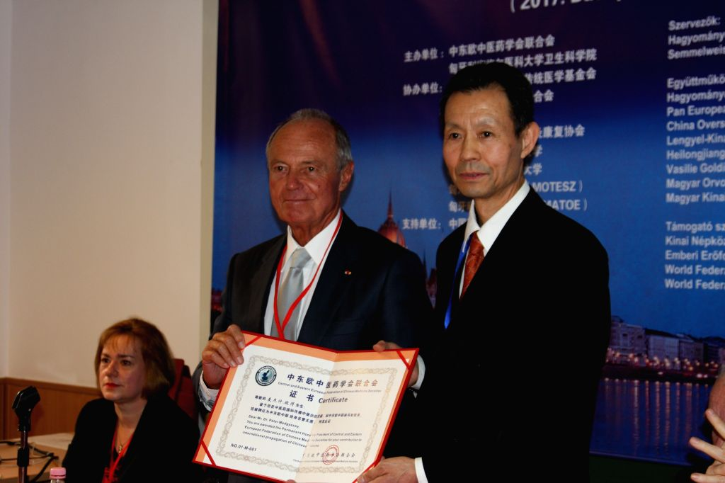 BUDAPEST, March 5, 2017 - President of the Central and Eastern European Federation of Chinese Medicine Societies Yu Funian (R) presents the letter of appointment as Permanent Honorary President of ... - Peter Medgyessy