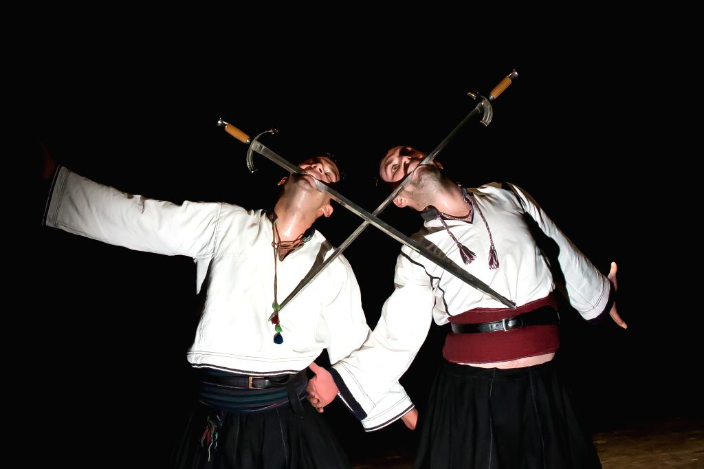 """Members of the Hungarian National Dance Ensemble perform during a dress rehearsal of """"The Bells Toll"""" in Budapest, Hungary, on Nov. 13, 2014. """"The Bells Toll"""" ..."""