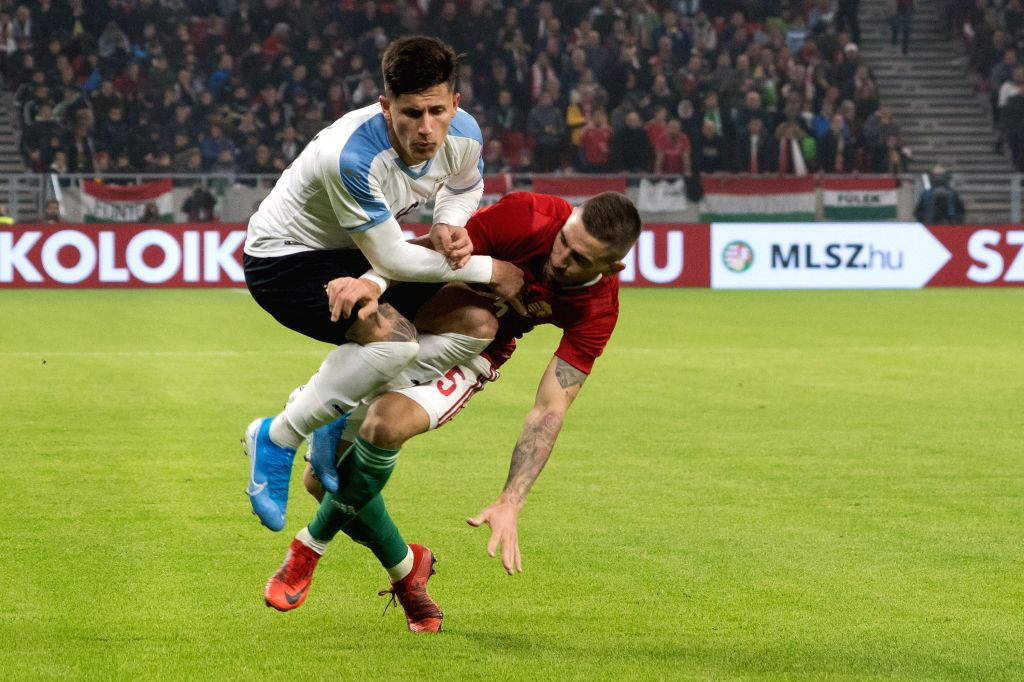 BUDAPEST, Nov. 16, 2019 - Brian Rodriguez (L) of Uruguay vies with Zsolt Nagy of Hungary during the inauguration match of the newly reconstructed Ferenc Puskas Stadium in Budapest, Hungary on Nov. ...