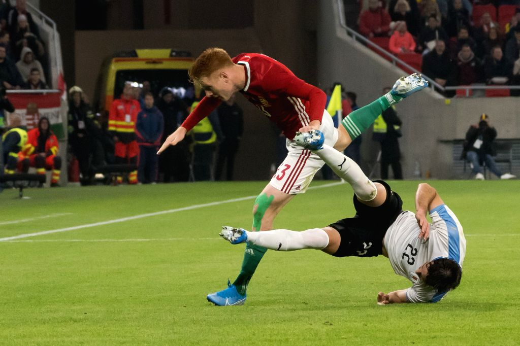 BUDAPEST, Nov. 16, 2019 - Zsolt Kalmar (L) of Hungary vies with Matias Vina of Uruguay during the inauguration match of the newly reconstructed Ferenc Puskas Stadium in Budapest, Hungary on Nov. 15, ...