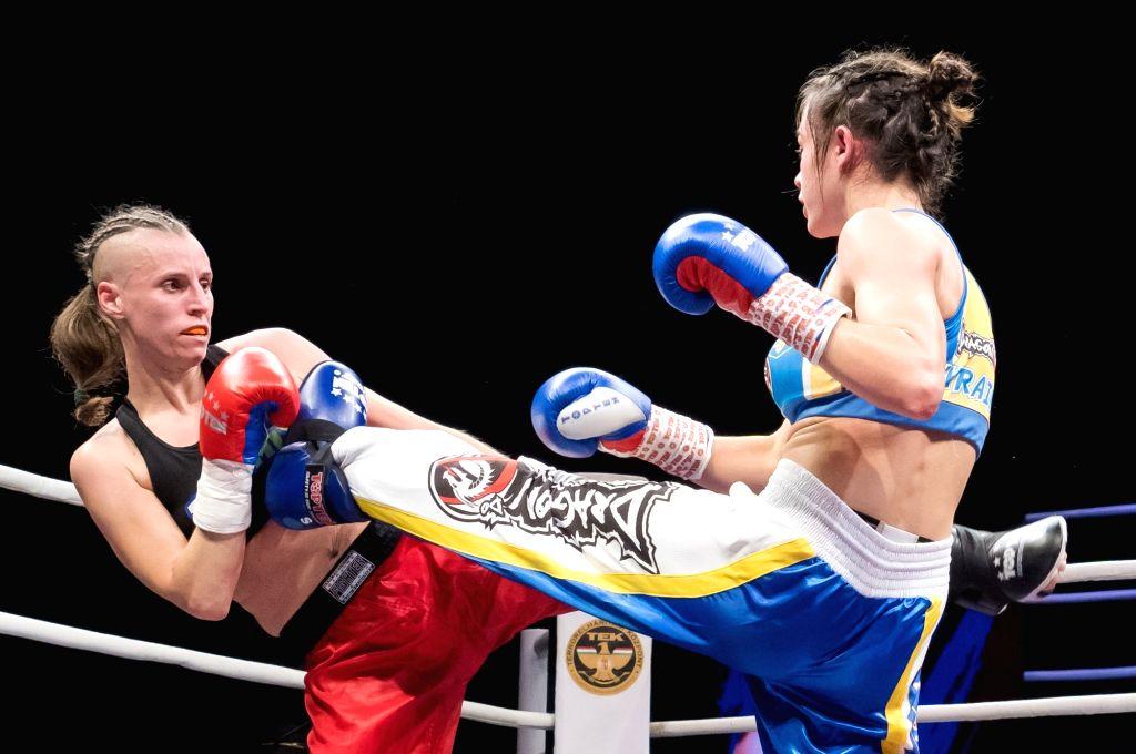 BUDAPEST, Nov. 17, 2019 - Renata Rakoczi (L) of Hungary fights with Antonina Osetska of Ukraine during the WAKO women's kick-boxing 55kg World Championship Final in Budapest, Hungary on Nov. 16, ...