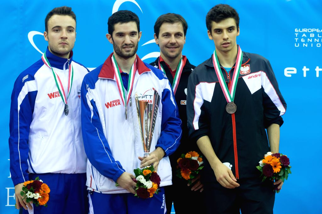 BUDAPEST, Oct. 24, 2016 - Gold medalist Emmanuel Lebesson (2nd L) of France, silver medalist Simon Gauzy (1st L) of France, bronze medalists Timo Boll (2nd R) of Germany and Jakub Dyjas of Poland ...