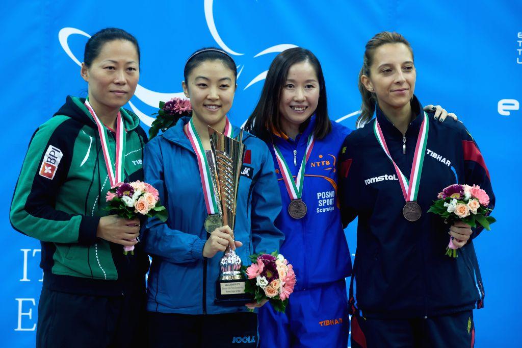 BUDAPEST, Oct. 24, 2016 - Gold medalist Hu Melek  (2nd L) of Turkey, silver medalist Yu Fu (1st L) of Portugal, bronze medalists Li Jie (2nd R) of Netherlands and Elizabeta Samara (1st R) of Romania ...