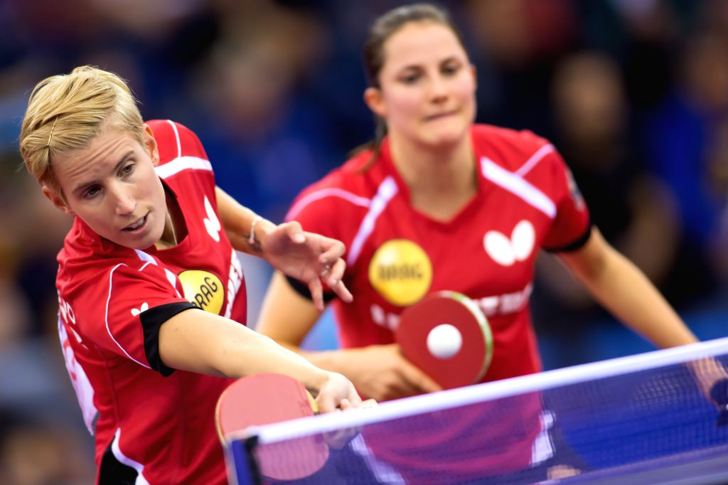 BUDAPEST, Oct. 24, 2016 - Kristin Silbereisen (L) and Sabine Winter of Germany compete during the women's doubles final at the 2016 ITTF European Table Tennis Championships in Budapest, Hungary, on ...