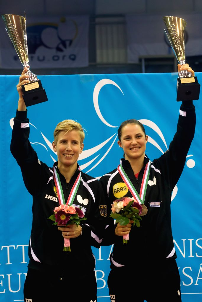 BUDAPEST, Oct. 24, 2016 - Kristin Silbereisen (L) and Sabine Winter of Germany pose on the podium during the awarding ceremony for the women's doubles event at the 2016 ITTF European Table Tennis ...