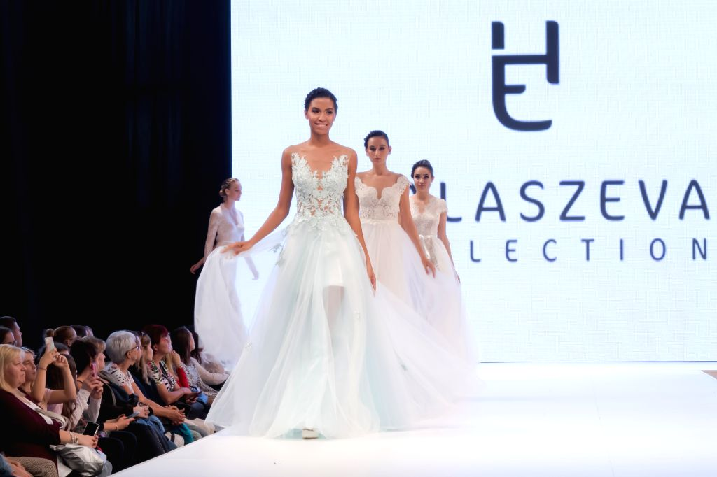 BUDAPEST, Oct. 28, 2019 - Models present wedding dress creations during a fashion show at the Wedding Expo held in Budapest, Hungary on Oct. 27, 2019.