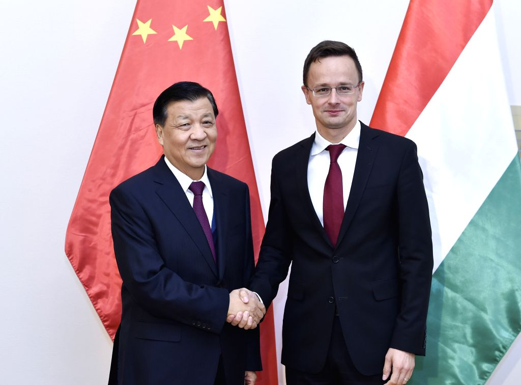 BUDAPEST, Oct. 7, 2016 - Liu Yunshan (L), a member of the Standing Committee of the Political Bureau of the Communist Party of China Central Committee, meets with Hungarian Minister of Foreign ...