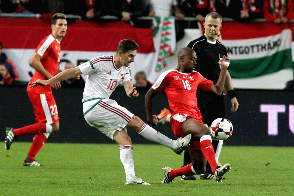 BUDAPEST, Oct. 8, 2016 - Switzerland's Gelson Fernandes (Frong, R) and Hungary's Zoltan Gera (Front, L) fight for the ball during the 2018 World Cup qualification match between Switzerland and ... - Gelson Fernandes