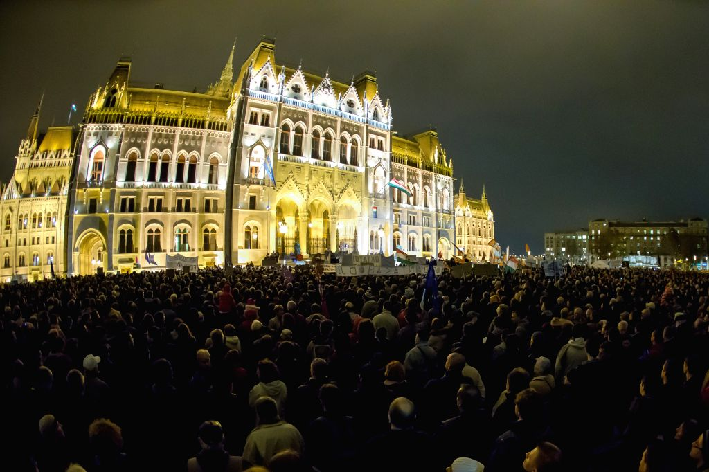 "People attend a large-scale demonstration in front of Parliament to protest a laundry list of issues they consider government wrongs in what has been dubbed ""Public Outrage Day"" .."
