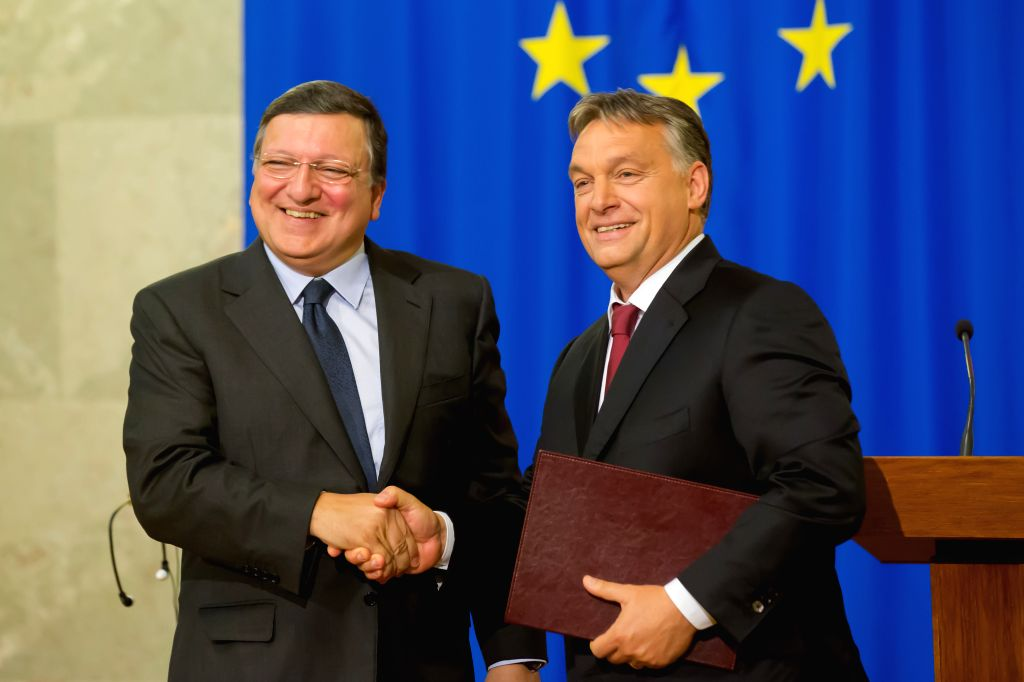 Outgoing European Commission President Jose Manuel Barroso(L) shakes hands with Hungarian Prime Minister Viktor Orban in Budapest, Hungary, on Sept. 11, 2014. ... - Viktor Orban
