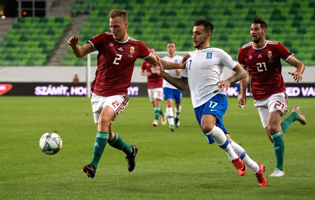 BUDAPEST, Sept. 12, 2018 - Adam Lang (L) of Hungary vies with Anastasios Donis (C) of Greece during the UEFA Nations League match between Hungary and Greece at the Groupama Arena stadium in Budapest, ...
