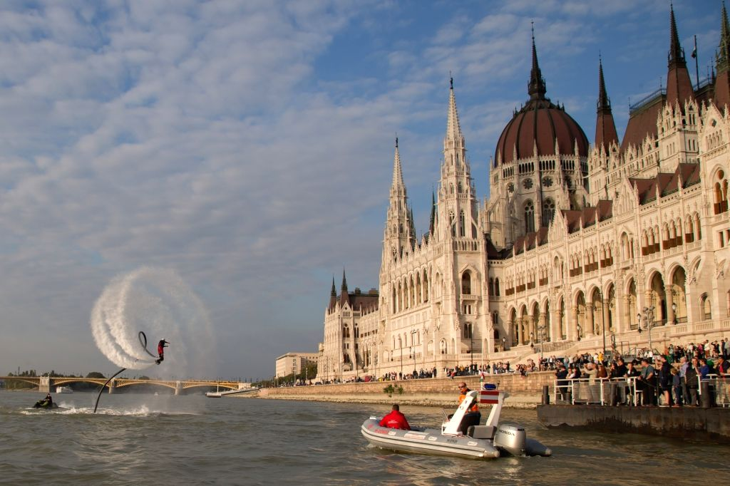 BUDAPEST, Sept. 30, 2017 - A flyboard rider performs with a water-propelled flyboard on the Danube River in front of the Hungarian Parliament in Budapest, Hungary, on Sept. 29, 2017.