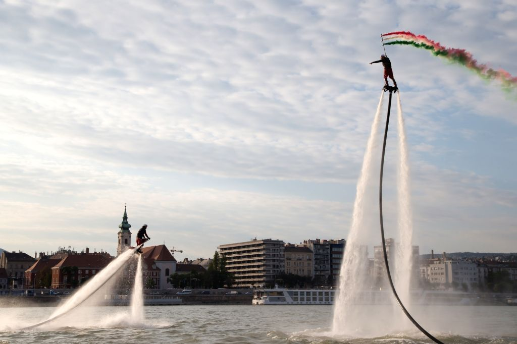 BUDAPEST, Sept. 30, 2017 - Flyboard riders perform with water-propelled flyboards on the Danube River in Budapest, Hungary, on Sept. 29, 2017.