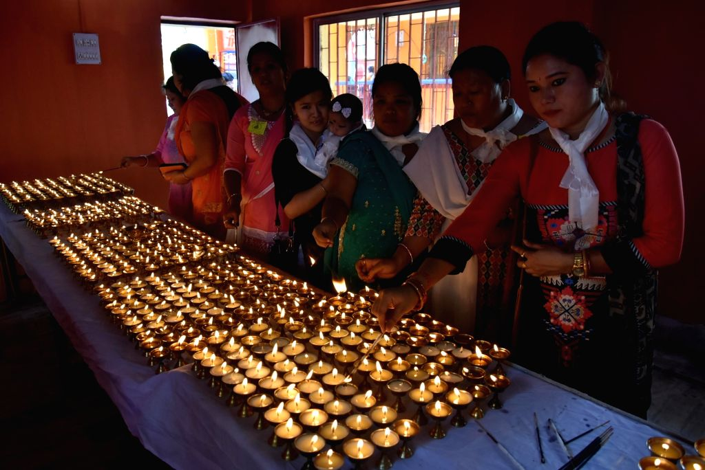 Buddhist devotees light candles on Buddha Purnima at Jharkhand Armed Police (JAP-1) ground in Ranchi on May 10, 2017.