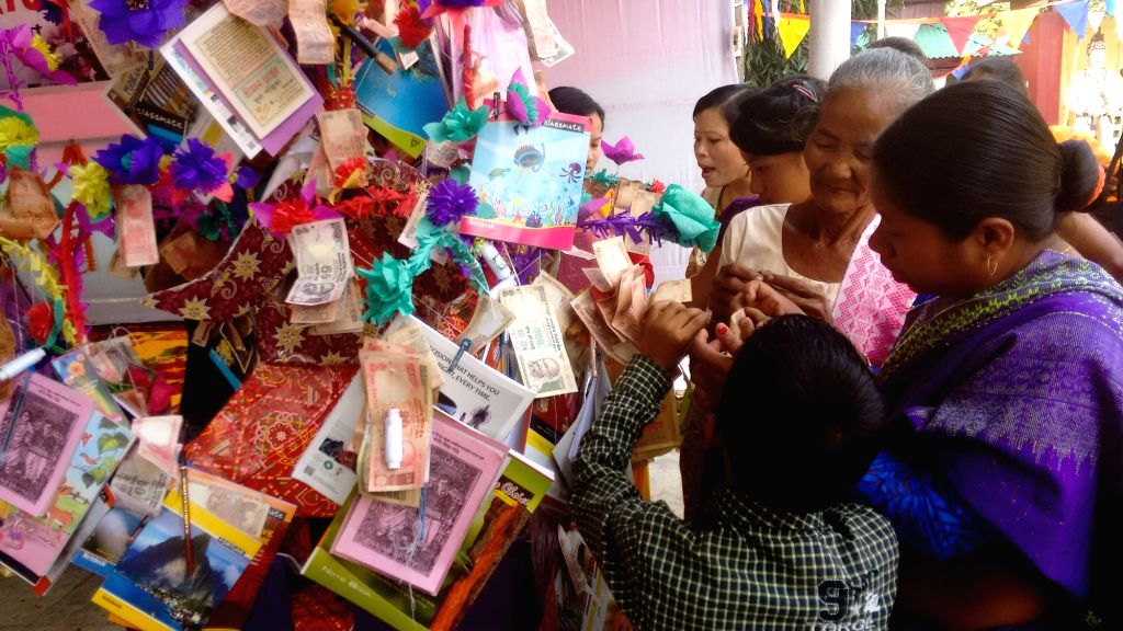 Buddhist devotees ties currency notes in the wish tree as they celebrate Kothinchibar Festival in Agartala on Nov 15, 2015.