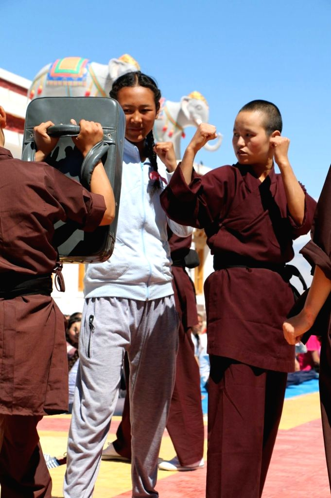 Buddhist Kung Fu nuns kicking hard at centuries-old taboos