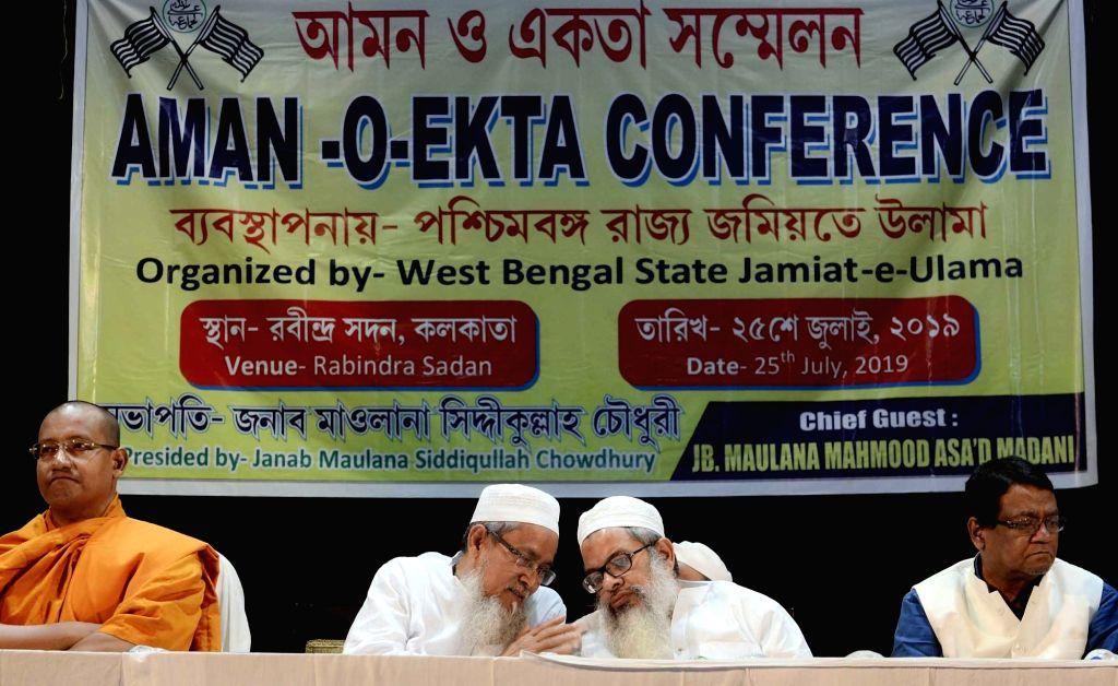 Buddhist monk Arunjyoti Bhikkhu, Jamiat Ulema-e-Hind General Secretary Maulana Mahmood Madani and the organisation's West Bengal President Siddiqullah Chowdhury during 'Aman-O-Ekta' ...