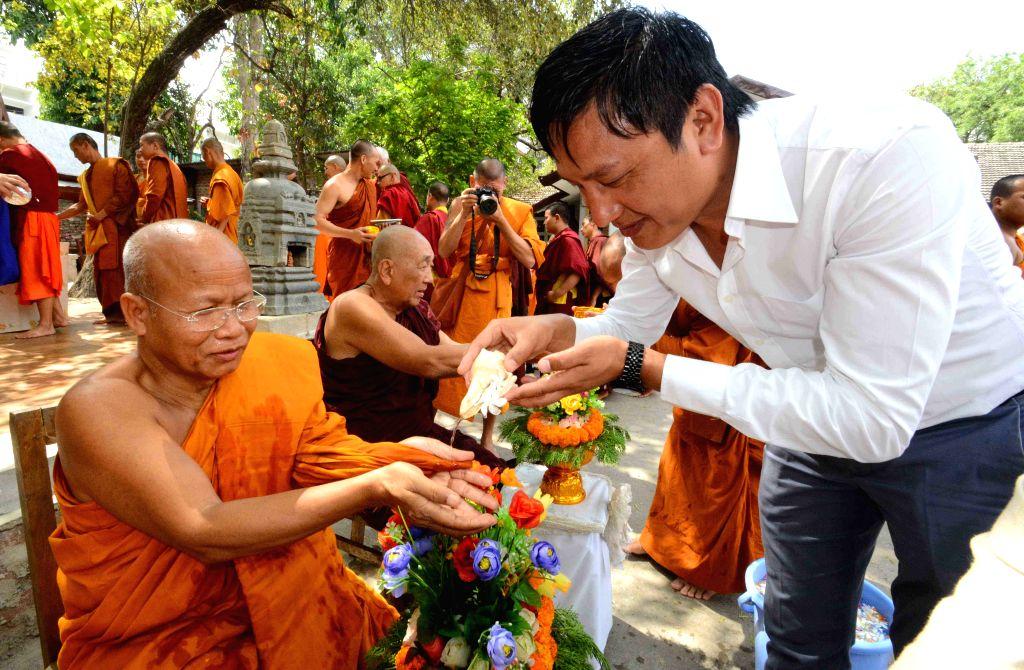 Buddhist monks from Thailand offer prayers during Songkran festival at Bodh Gaya's Thai Temple on April 13, 2015.