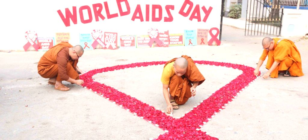 Buddhist monks light lamps during an awareness rally organised on the occasion of World AIDS Day in Kolkata, on Dec 1, 2018.