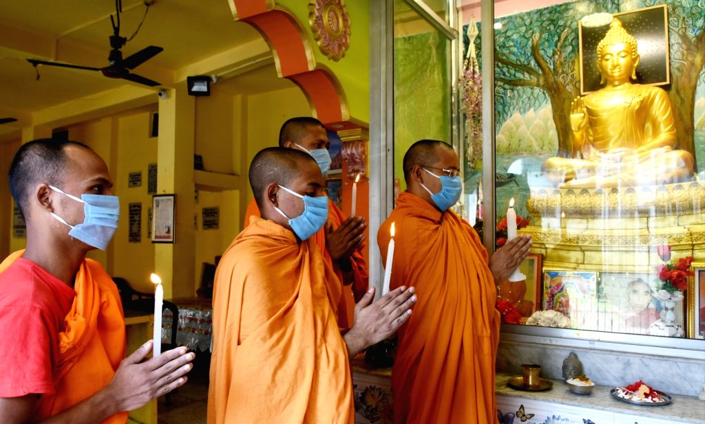 Buddhist monks offer prayers to Lord Buddha at a Buddhist Temple in Kolkata during the extended nationwide lockdown imposed to mitigate the spread of coronavirus; on Apr 25, 2020.