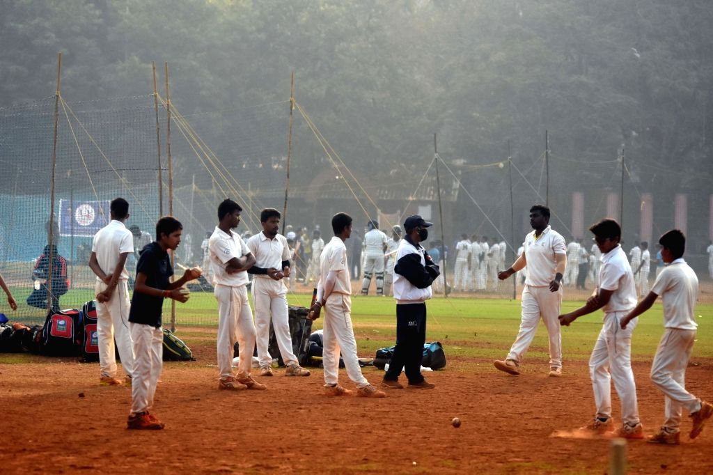 Budding cricketers at Shivaji Park, Dadar in Mumbai warm hearts of morning crowd despite rising cases in the city, strict Covid norms may be clamped again.(photo:IANS/Sandeep Mahankal)