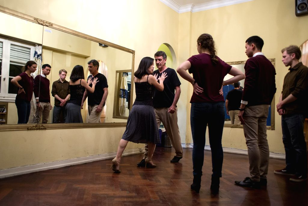 BUENOS AIRES, April 18, 2017 - Shelly Hou (1st L) and Juan Berthier (2nd L), a Sino-Argentinean couple, give a tango lesson to foreign students in Buenos Aires, Argentina on April 13, 2017. China and ...