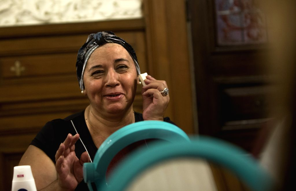"""Image taken on April 22, 2014, shows Maria Cristina Alanis reacting in a make up class during the programme """"Look Good... Feel Better"""" (LBSM, for ..."""