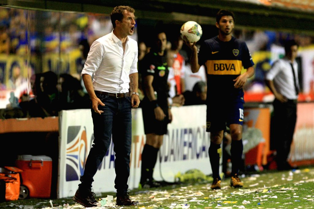 Buenos Aires (Argentina): Head coach Rodolfo Arruabarrena (L) of Boca Juniors reacts during the first leg match of South American Cup semifinals, against River Plate, held at Alberto J. Armando ...