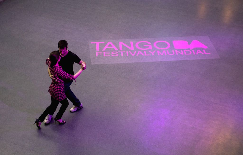 A couple dances tango during the Tango Festival of Buenos Aires, Argentina, on Aug. 15, 2014.